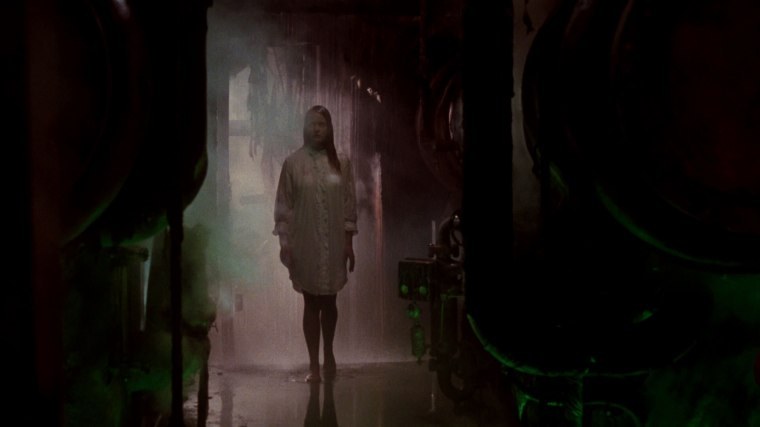 Such as here, where she's gained the ability to walk down a hallway without her shirt becoming see-through. A first for horror, hooray!